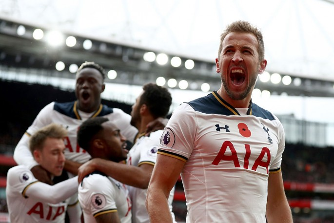 tottenham-hotspur-striker-harry-kane-r-shouts-as-his-teammates-celebrate-his-goal-against-arsenal.jpg